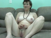 Older babe shows her tight wet pussy