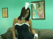 Sexy bunny girl pampers her wet pussy