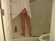 Naked chick caught on cam on a bathroom