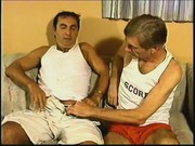 Two mature men perform barebacking
