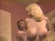 Blonde chick uses bosoms for foreplay